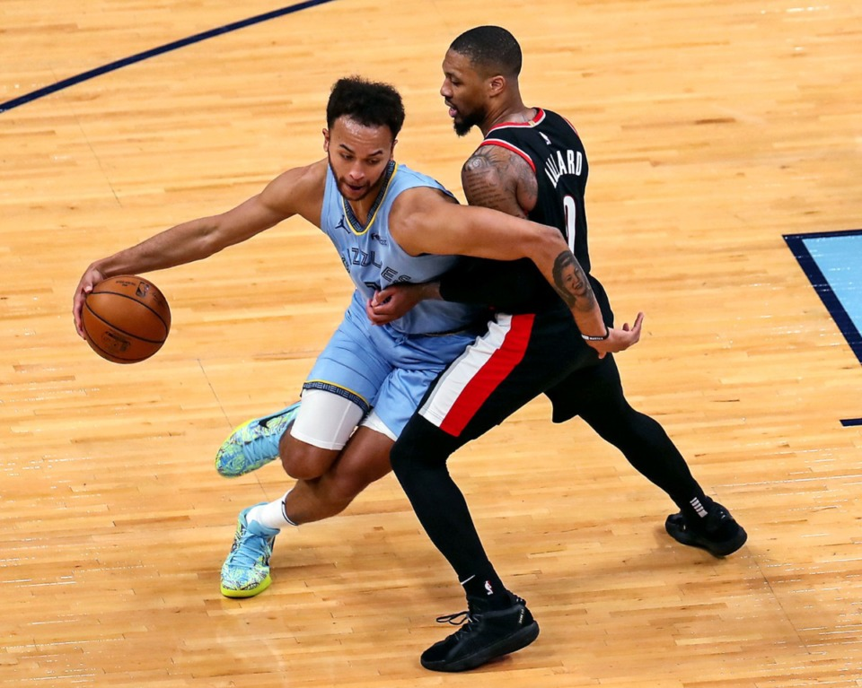 <strong>Grizzlies forward Kyle Anderson (1) tries to get around Portland&rsquo;s Damian Lillard (0) on April 28 at FedExForum.</strong> (Patrick Lantrip/Daily Memphian)