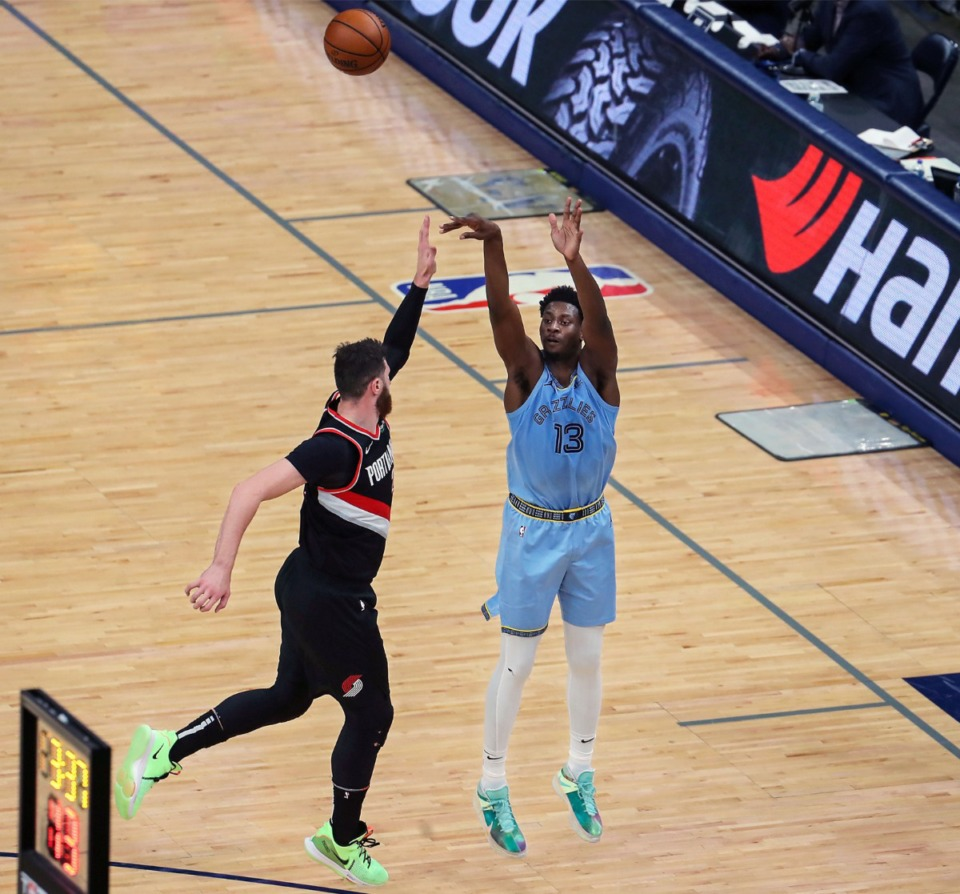 <strong>Grizzlies forward Jaren Jackson Jr. (13) shoots a three against Portland on April 28 at FedExForum.</strong> (Patrick Lantrip/Daily Memphian)