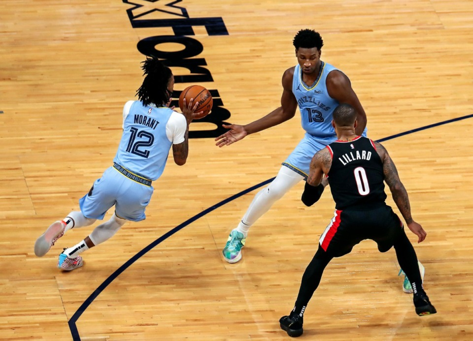 <strong>Grizzlies forward Jaren Jackson Jr. (13) hands the ball off to Ja Morant (12) on April 28 at FedExForum on April 28.</strong> (Patrick Lantrip/Daily Memphian)