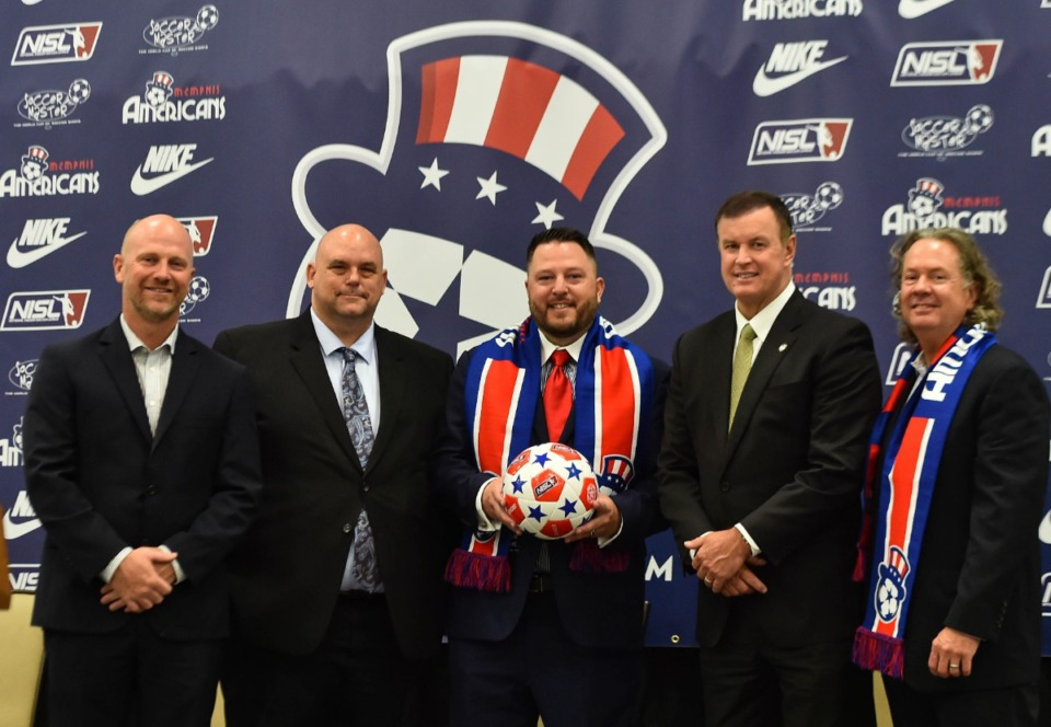 <strong>Jason Gibson (left) and Joshua Blair (second from left) are members of the National Indoor Soccer League board of directors. Andrew Haines (center) is a member of the NISL executive board member and part of the ownership group; Darren Musselwhite (second from right) is Southaven mayor, and Todd Mastry is executive director of the Landers Center in Southaven.</strong> (Courtesy Memphis Americans)