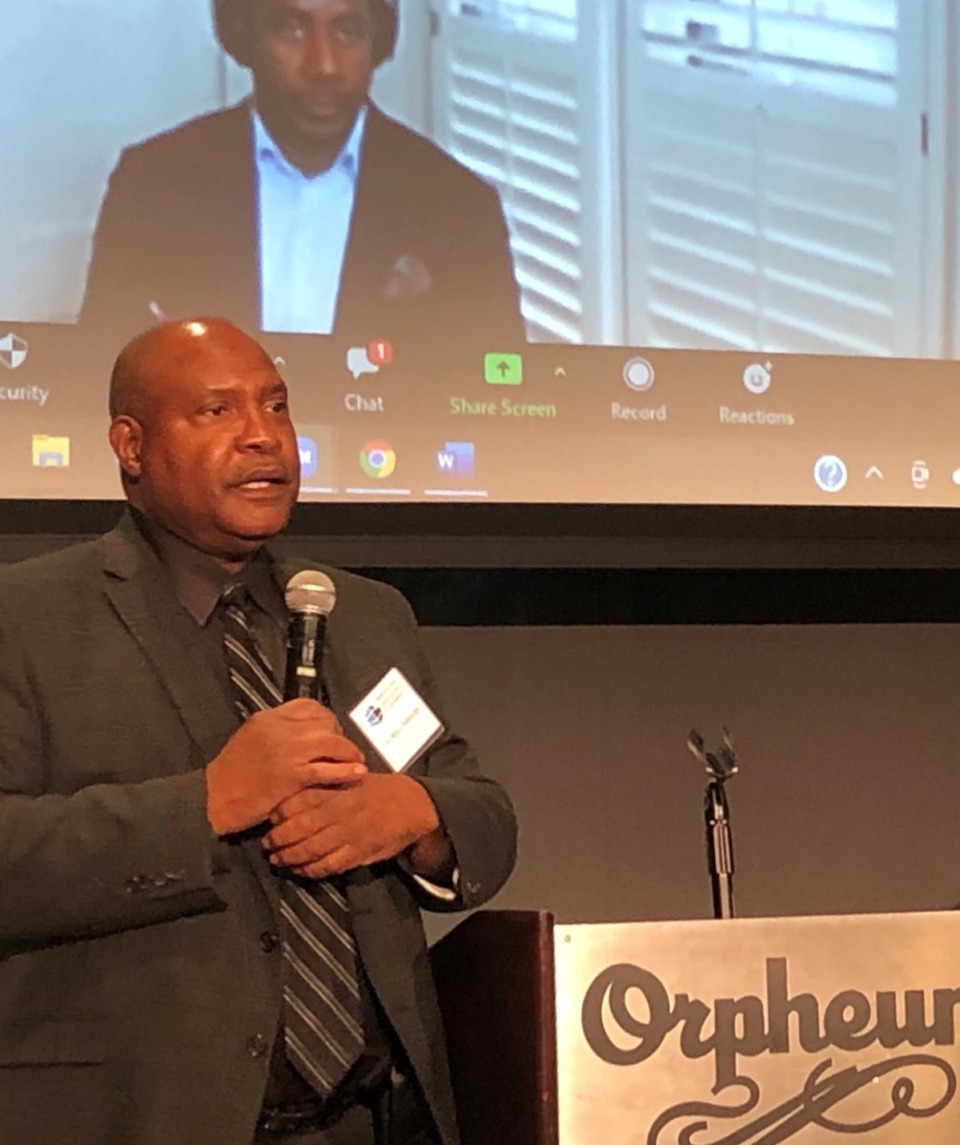 <strong>Dr. Bruce Randolph answers questions (with Douglas Scarboro on the screen over his shoulder) at the Memphis Area Association of Governments&rsquo; briefing Thursday, April 29, at the Halloran Centre for Performing Arts &amp; Education.</strong> (Jane Robets/The Daily Memphian)
