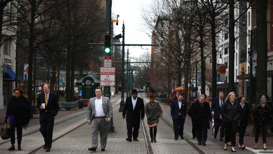 <strong>Greater Memphis Chamber board members conduct their ceremonial walk from the Falls Building to City Hall, where late chamber president and CEO Phil Trenary was posthumously presented the 2018 Memphis City Council Humanitarian Award on Tuesday, Jan. 22, 2019. Trenary was fatally shot in Downtown Memphis in September.</strong> (Houston Cofield/Daily Memphian)