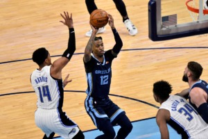 <strong>Grizzlies guard Ja Morant (12) is defended by Orlando Magic guard Gary Harris (14) on April 30 at FedExForum.</strong> (Brandon Dill/AP)