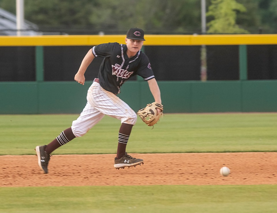 <strong>Collierville High School third baseman Joey Caruso chases after a ground ball in Friday's game with ECS in Collierville.</strong> (Greg Campbell/Special to The Daily Memphian)