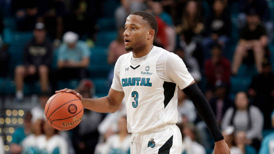 <strong>Coastal Carolina guard Devante Jones announced Saturday morning that he will transfer to Michigan. He had considered Memphis. </strong>(AP Photo/Gerry Broome file)