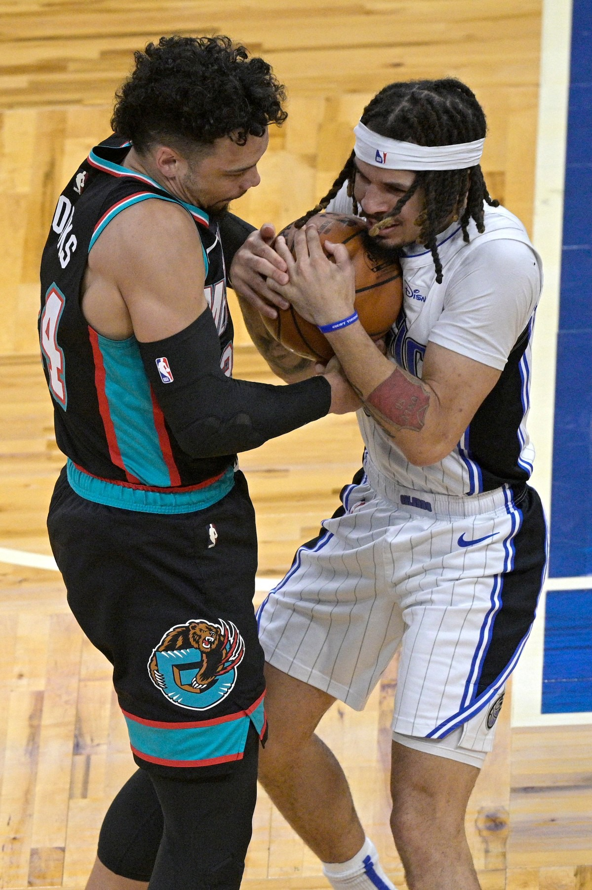 <strong>Memphis Grizzlies forward Dillon Brooks, left, ties up Orlando Magic guard Cole Anthony, forcing a jump ball, during the first half of an NBA basketball game, Saturday, May 1, 2021, in Orlando, Fla.</strong> (Phelan M. Ebenhack/AP)