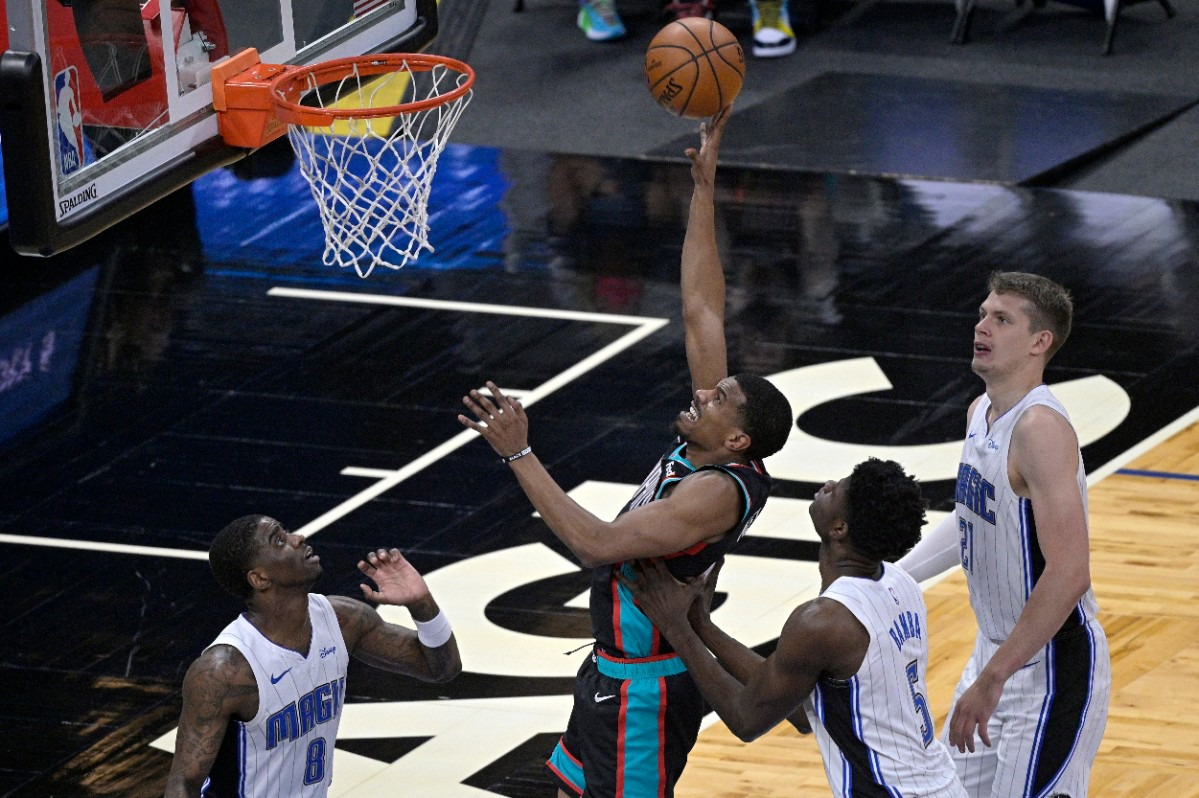 <strong>Memphis Grizzlies guard De'Anthony Melton, second from left, goes up to shoot between Orlando Magic forward Dwayne Bacon (8), center Mo Bamba (5) and center Moritz Wagner (21) during the first half of an NBA basketball game, Saturday, May 1, 2021, in Orlando, Fla.</strong> (Phelan M. Ebenhack/AP)