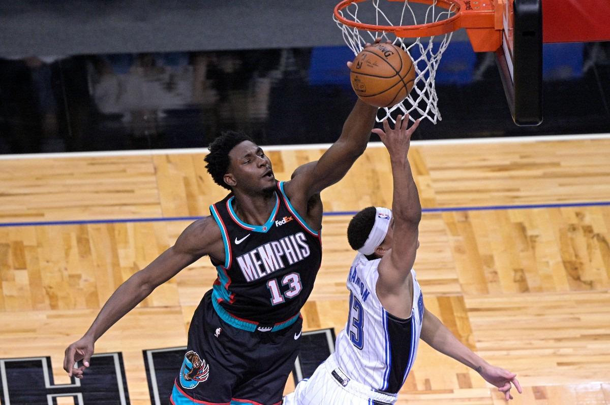 <strong>Memphis Grizzlies forward Jaren Jackson Jr. (13) blocks a shot by Orlando Magic guard R.J. Hampton (13) during the first half of an NBA basketball game, Saturday, May 1, 2021, in Orlando, Fla.</strong> (Phelan M. Ebenhack/AP)