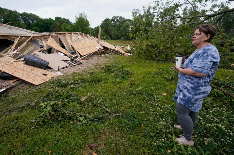 <strong>Vickie Savell looks at the remains of her new mobile home early Monday, May 3, 2021, in Yazoo County, Miss. Multiple tornadoes were reported across Mississippi on Sunday, causing some damage but no immediate word of injuries.</strong> (Rogelio V. Solis/AP)