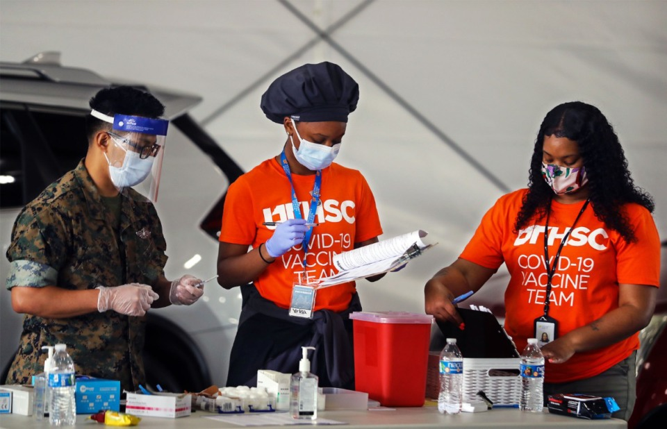 <strong>Volunteers prepare COVID-19 vaccines outside of the Pipkin Building April 7, 2021.</strong> (Patrick Lantrip/Daily Memphian)