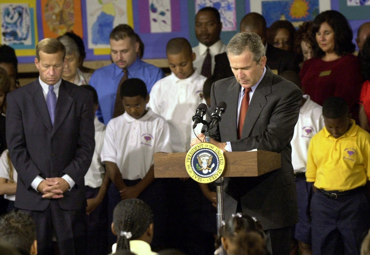 <strong>President George W. Bush observed a moment of silence on Sept. 11, 2001, at the Emma E. Booker Elementary School in Sarasota, Florida, for victims of the terrorist attacks. Bush had chosen the school in one of Sarasota's poorest neighborhoods to launch a national reading campaign. Though the day&nbsp;forever altered Bush&rsquo;s presidential priorities, it didn&rsquo;t end his push for education reform.</strong> (Chris O'Meara/AP file)