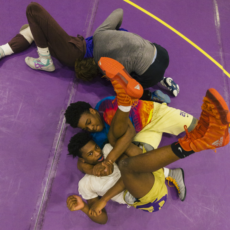 <strong>Christian Brothers High School wrestler Al Wooten (in tie-dyed shirt) is wasting little time in establishing himself as a serious state-title threat. Wooten, a CBHS junior, won the tournament championship at the Halls Invitational in Knoxville over the weekend, breaking the CBHS record with 35 pins in a season.&nbsp;</strong>(Ziggy Mack/Special to the Daily Memphian)