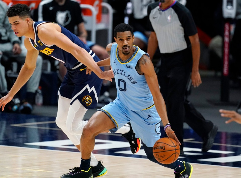 <strong>Grizzlies guard De'Anthony Melton, right, picks up the ball on April 19 in Denver.&nbsp;&ldquo;Whatever spot we get to, we have to control our own destiny,&rdquo; he says.</strong>&nbsp;(David Zalubowski/AP)