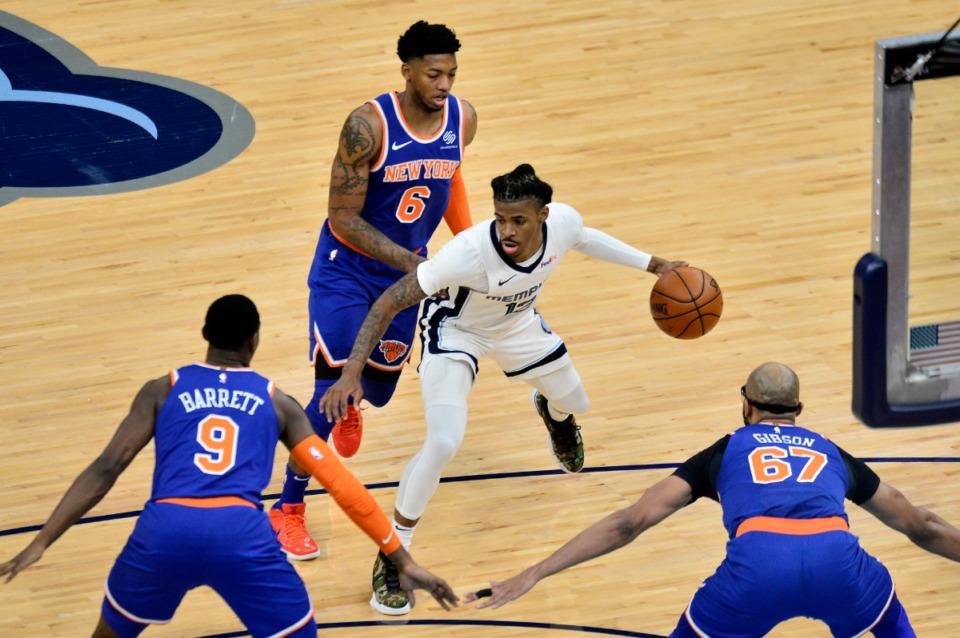 <strong>Grizzlies guard Ja Morant (12) finds himself triple-teamed by Knicks Elfrid Payton (6), RJ Barrett (9) and center Taj Gibson (67) on May 3 at FedExForum.</strong> (Brandon Dill/AP)