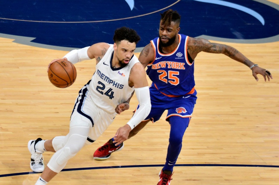 <strong>Grizzlies forward Dillon Brooks (24) charges past New York Knicks forward Reggie Bullock (25) on May 3 at FedExForum</strong>. (Brandon Dill/AP)