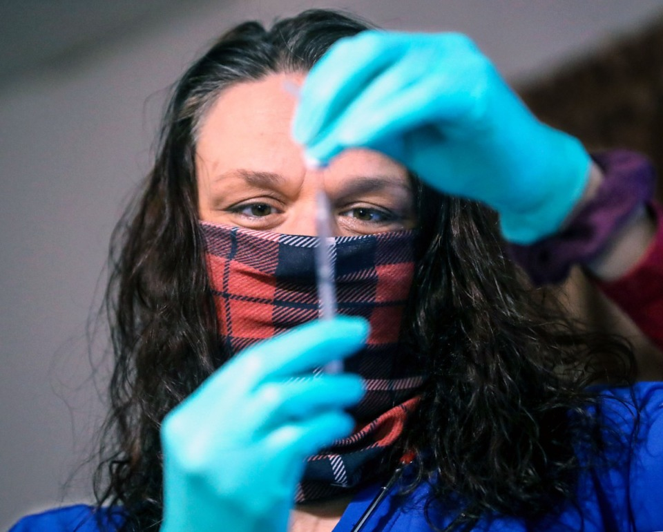 <strong>Jennifer Mohundro draws up a COVID-19 vaccine during a March 19, 2021 home visit.</strong> (Patrick Lantrip/Daily Memphian file)