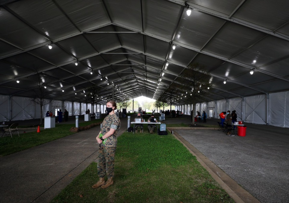 <strong>Lt. Sydney Murkins stands inside the tent erected outside the Pipkin Building to deliver COVID-19 vaccines on April 7.</strong> (Patrick Lantrip/Daily Memphian)