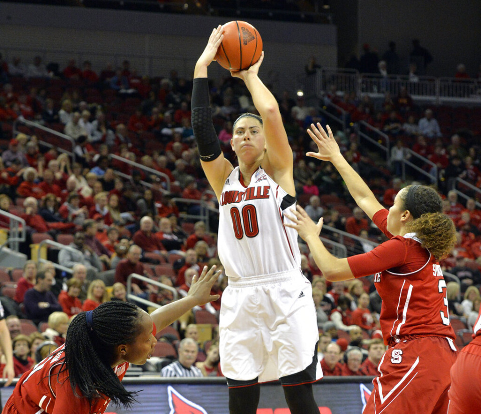 <strong>In this 2015 photo, Sara Hammond puts up a shot between the defense of NC State's Jennifer Mathurin, left, and Miah Spencer during the second half of their NCAA basketball game in Louisville, Kentucky. Hammond is the new girls basketball coach at Lausanne.</strong> (AP Photo/Timothy D. Easley)