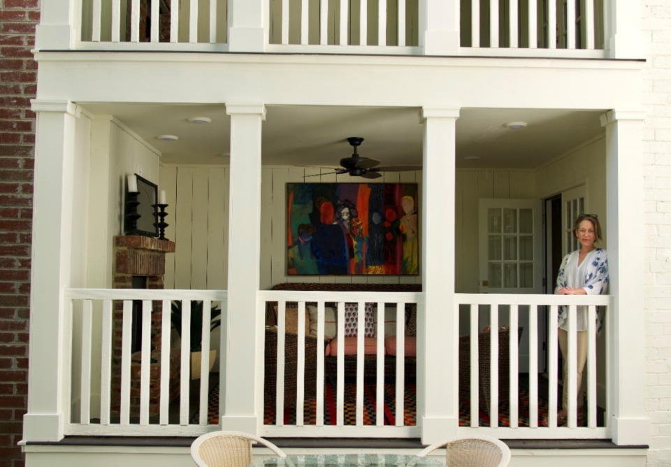 <strong>The new front porches, with fireplaces, provide a place to view the leafy Chickasaw Gardens neighborhood.</strong> (Tom Bailey/Daily Memphian)