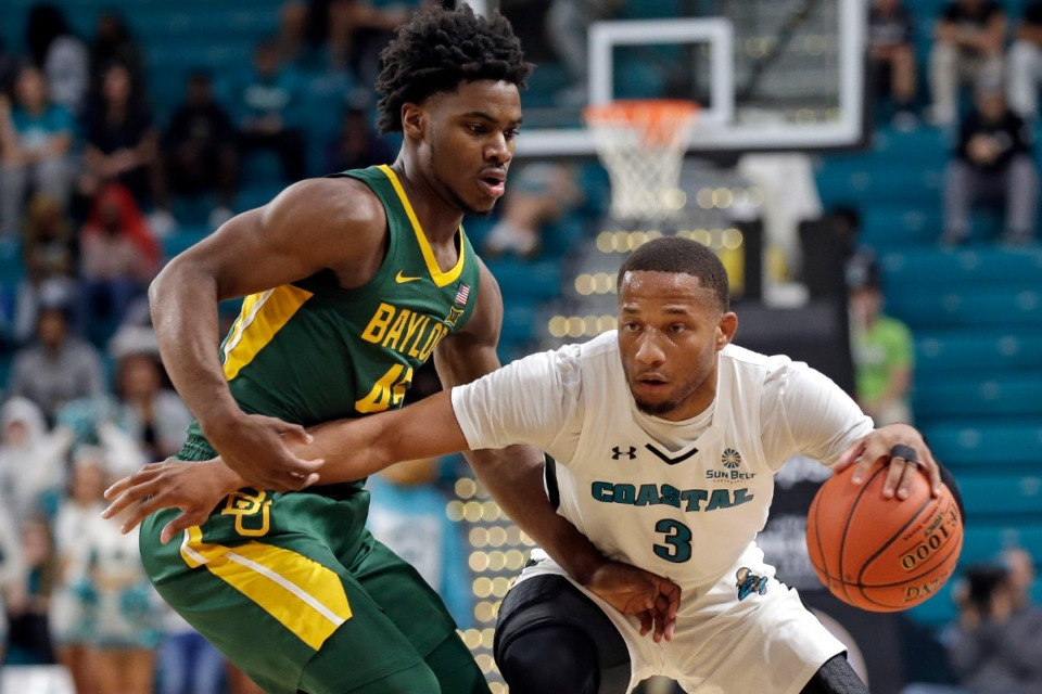 <strong>The Tigers pursued Coastal Carolina guard DeVante&rsquo; Jones (with ball in 2019) who decided on Michigan.</strong> (Gerry Broome/AP file)