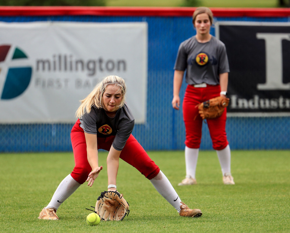 <strong>Tipton-Rosemark's Ryleigh Bowers fields the ball while Lillie Garner looks on during an April 30, 2021 practice.</strong> (Patrick Lantrip/Daily Memphian)