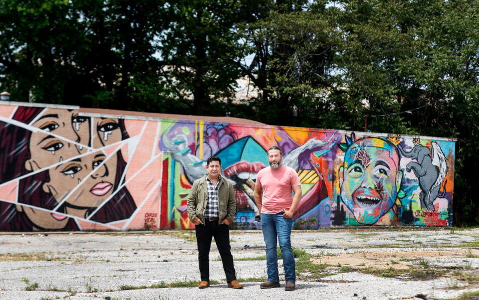 <strong>Partners Eduardo Sanchez Borja (left) and Jorge De Ochoa Jr. stand on 4.62 acres Tuesday, May 4, 2021 on Lamar Avenue near Roland Street. They plan a commercial, residential and community development on the property.</strong> (Mark Weber/The Daily Memphian)