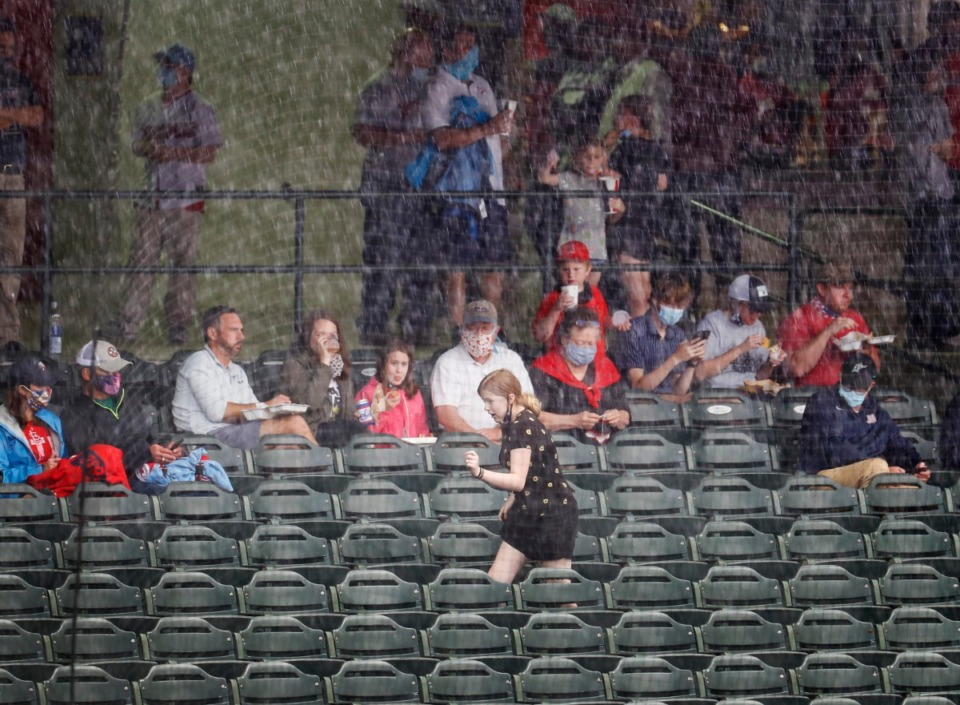 <strong>Fans run for cover during a rain delay before the Redbirds take on the Durham Bulls on Tuesday, May 4, 2021, at AutoZone Park.</strong> (Mark Weber/The Daily Memphian)