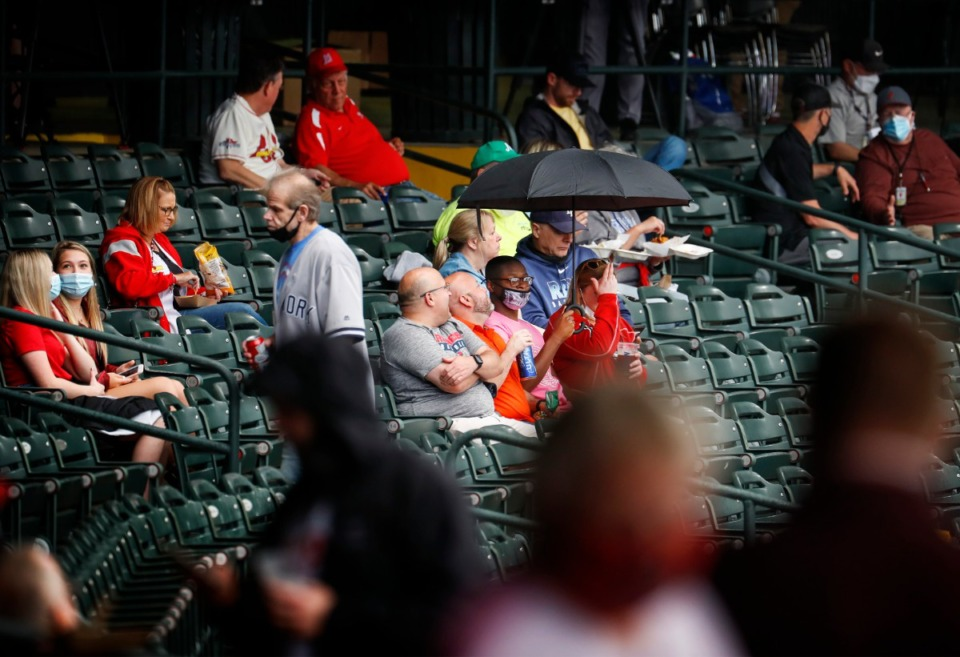 <strong>Redbirds fans wait out the rain delay before Memphis takes on the Durham Bulls on Tuesday, May 4, 2021.</strong> (Mark Weber/The Daily Memphian)