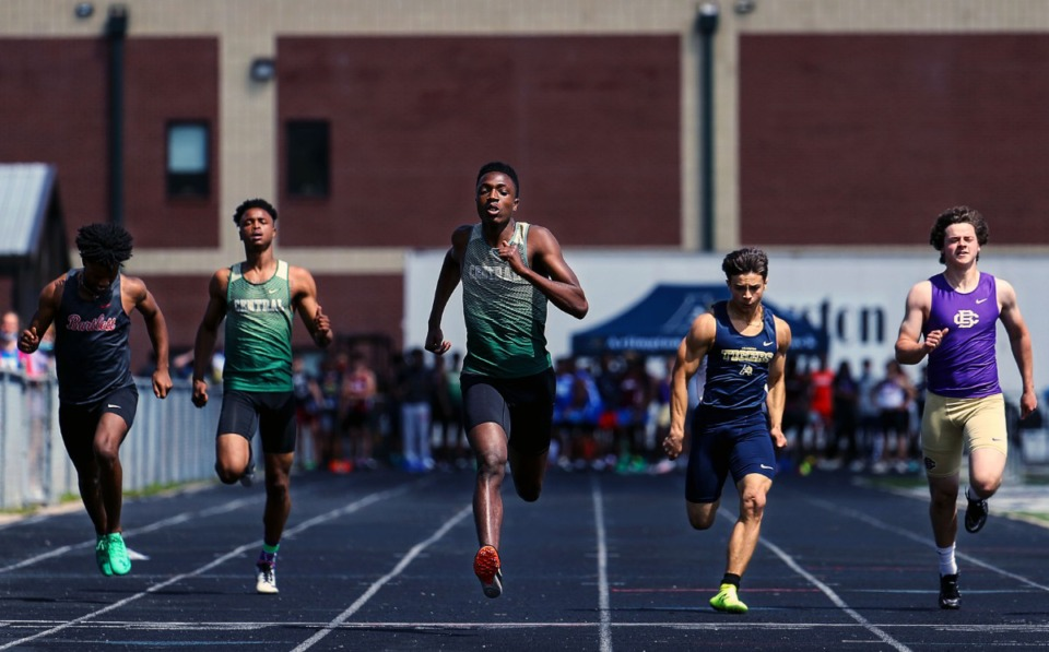 <strong>Central High School's Jordan Ware (center) wins the men's 100 meter dash at the Houston Track and Field Classic at Houston High School April 10, 2021.</strong> (Patrick Lantrip/Daily Memphian)