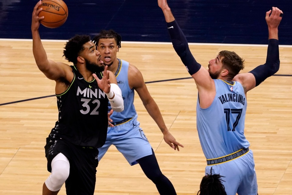 <strong>Minnesota&rsquo;s Karl-Anthony Towns (32) shoots as Grizzlies center Jonas Valanciunas (17) defends on May 5, 2021, in Minneapolis.</strong> (Jim Mone/AP)