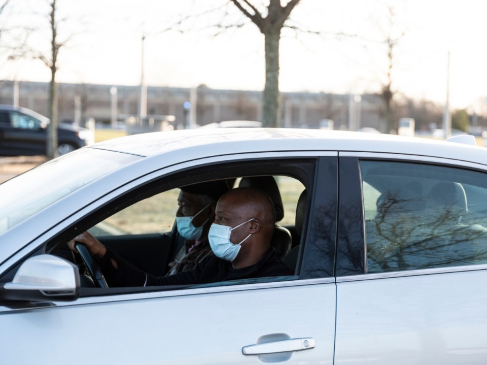 <strong>Tyrone Currie, right, drives his parents, James Thomas Currie, left, and Luvenia Currie, while waiting to receive their COVID-19 vaccine inside the Pipkin Building, Jan. 29, 2021. </strong>(Brad Vest/Special to the Daily Memphian file)