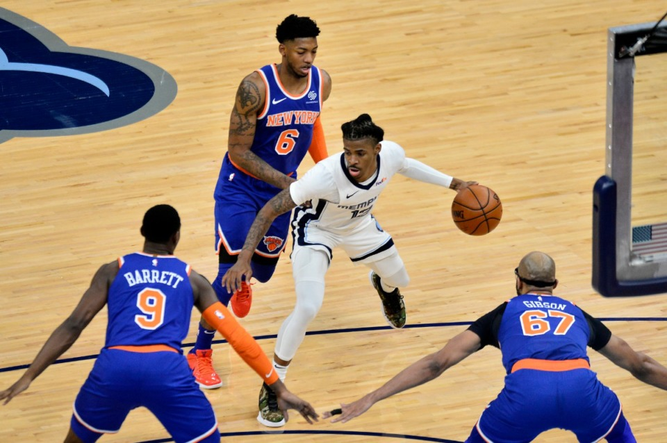 <strong>Memphis Grizzlies guard Ja Morant (12) handles the ball between New York Knicks guards Elfrid Payton (6) and RJ Barrett (9), and center Taj Gibson (67) in the first half of an NBA basketball game Monday, May 3, 2021, in Memphis.</strong> (AP Photo/Brandon Dill)