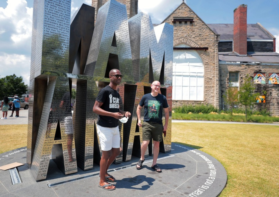 <strong>Laquentus Jones (left) and Shawn Mathews posed at I Am a Man Plaza while on a caravan tour of Memphis Civil Rights historical locations.</strong> (Patrick Lantrip/Daily Memphian file)