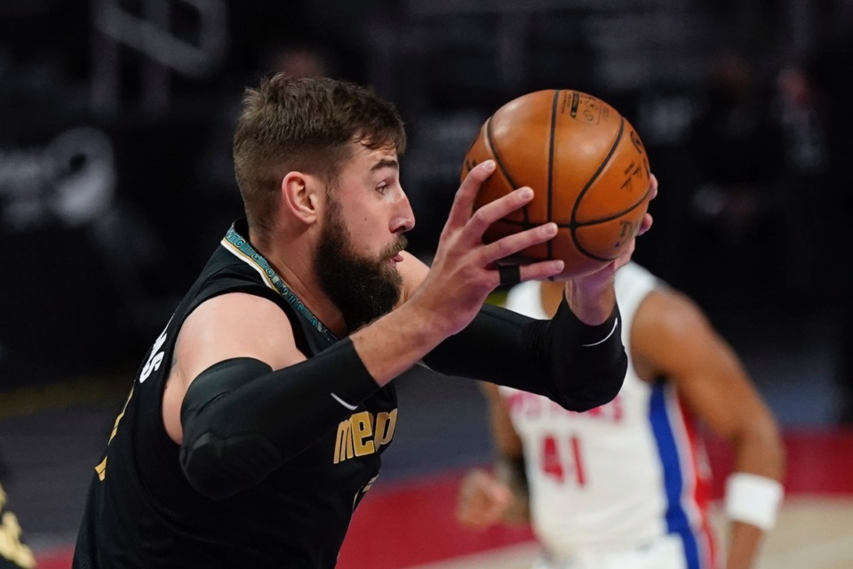 <strong>Grizzlies center Jonas Valanciunas grabs a rebound in the game against the Detroit Pistons on May 6, 2021, in Detroit.</strong> (Carlos Osorio/AP)