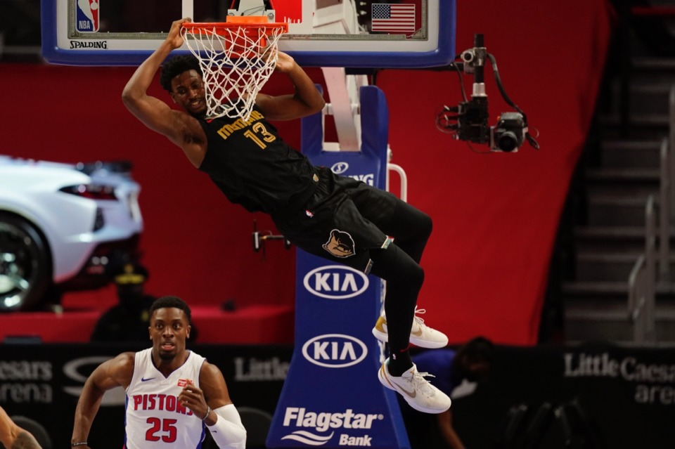 <strong>Grizzlies forward Jaren Jackson Jr. hangs on the rim after a dunk in the game against the Detroit Pistons on May 6, 2021, in Detroit.</strong> (Carlos Osorio/AP)