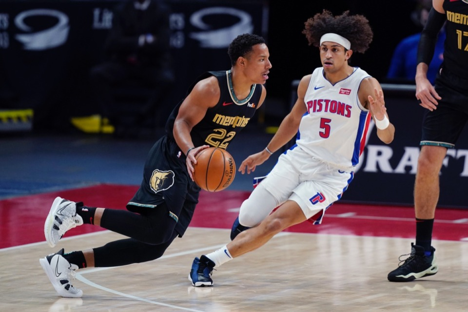 <strong>Grizzlies guard Desmond Bane (22) drives past Detroit&rsquo;s Frank Jackson (5) on May 6, 2021, in Detroit.</strong> (Carlos Osorio/AP)