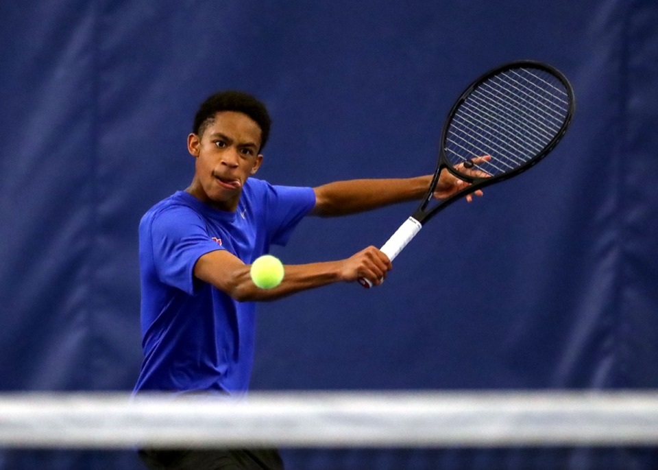 <strong>MUS tennis player Justin Martin keeps his eye on the ball during a May 6, 2021, match.</strong> (Patrick Lantrip/Daily Memphian)