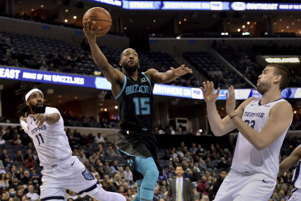 <span><strong>Charlotte Hornets guard Kemba Walker (15) shoots between Memphis Grizzlies guard Mike Conley (11) and center Marc Gasol on Wednesday, Jan. 23, 2019, in Memphis, Tenn.</strong> (AP Photo/Brandon Dill)</span>