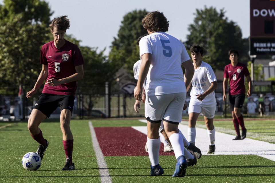 <strong>Evangelical Christian School&rsquo;s Brett Ross brings the ball up the pitch May 7 against Northpoint.</strong> (Brad Vest/Special to The Daily Memphian)