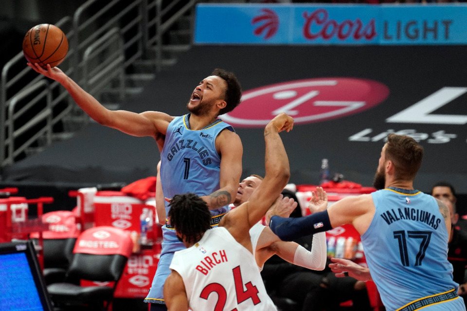 <strong>Memphis Grizzlies forward Kyle Anderson (1) puts up a shot over Toronto Raptors center Khem Birch (24) during the first half of an NBA basketball game Saturday, May 8, 2021, in Tampa, Fla.</strong> (AP Photo/Chris O'Meara)