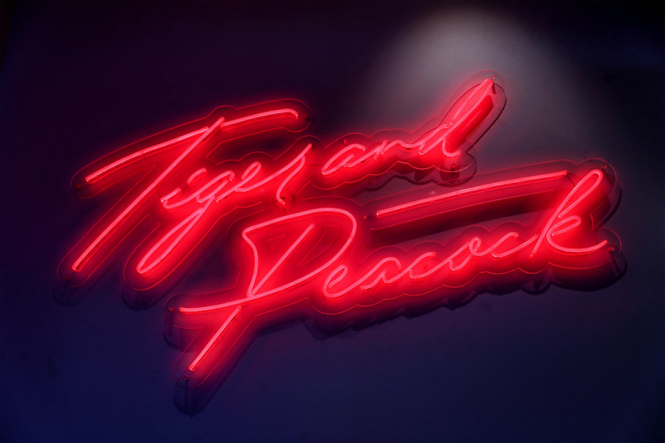 <strong>A neon sign for Tiger and Peacock, The Memphian Hotel's rooftop bar, hangs in the lobby.</strong> (Patrick Lantrip/Daily Memphian)