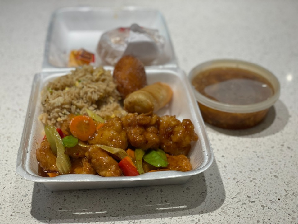 <strong>Dah chine chicken with fried rice, a spring roll, Chinese doughnut and hot and sour soup is $8.95 for lunch at Panda Garden.</strong> (Jennifer Biggs/Daily Memphian)