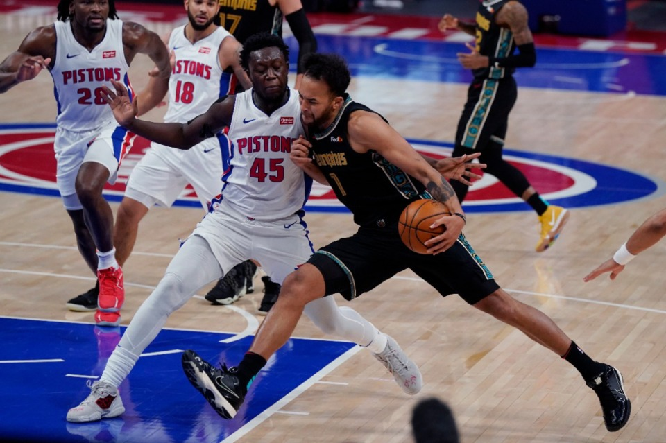 <strong>Memphis Grizzlies forward Kyle Anderson (1) runs into Detroit Pistons forward Sekou Doumbouya (45) during the second half of an NBA basketball game, Thursday, May 6, 2021, in Detroit.</strong> (Carlos Osorio/AP)