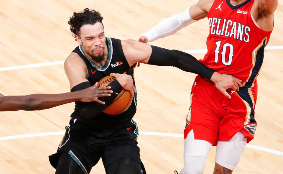 <strong>Memphis Grizzlies guard Dillon Brooks (left) drives the lane against the New Orleans Pelicans defense during action on Monday, May 10, 2021.</strong> (Mark Weber/The Daily Memphian)