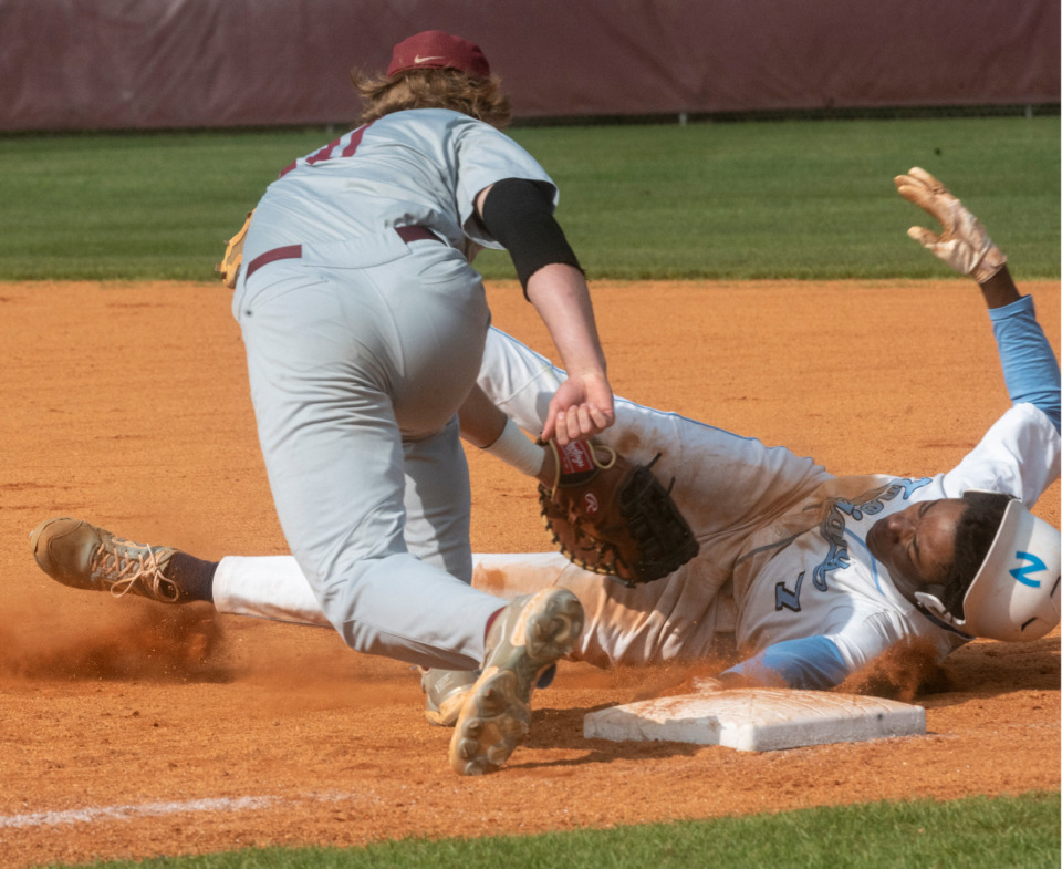 <strong>Northpoint Christian School's James Smith, Jr. is tagged out by ECS first baseman Peter Nearn during their game at St. George's Independent School, Monday, May 10, 2021. (</strong>Greg Campbell/Special to The Daily Memphian)
