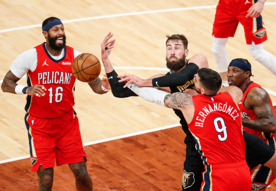 <strong>Memphis Grizzlies center Jonas Valanciunas (middle) battles New Orleans Pelicans defenders James Johnson (left) and Willy Hernangomez (right) for a rebound during action on Monday, May 10, 2021.</strong> (Mark Weber/The Daily Memphian)