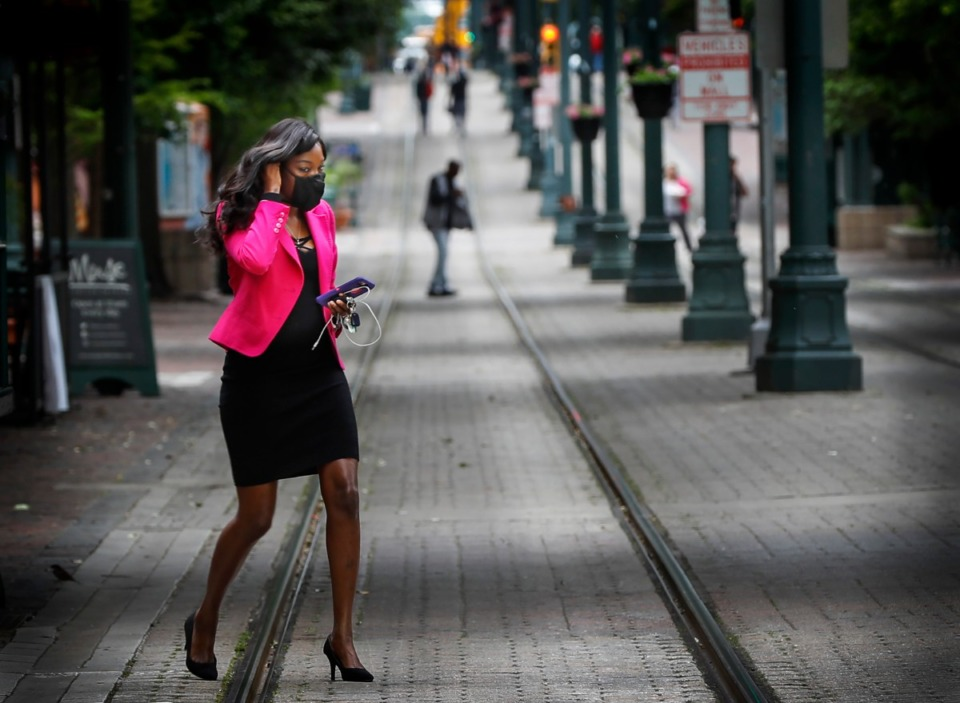 <strong>On this date, exactly a year ago, Sophia Townsend adjusted her face mask while walking down North Main Street.</strong> (Mark Weber/Daily Memphian file)