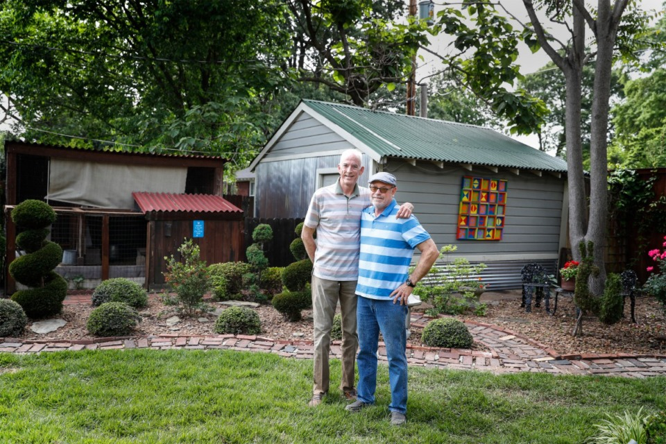 <strong>Tommy Langston (left) and Jimmy Thomason stand in their back garden on Monday, May 10. It will be featured in this year&rsquo;s Cooper-Young Garden Walk.</strong> (Mark Weber/Daily Memphian)