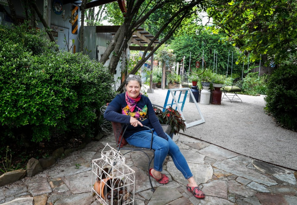 <strong>Sharron Johnson sits in her garden, which will be featured in this year&rsquo;s Cooper-Young Garden Walk.</strong> (Mark Weber/Daily Memphian)