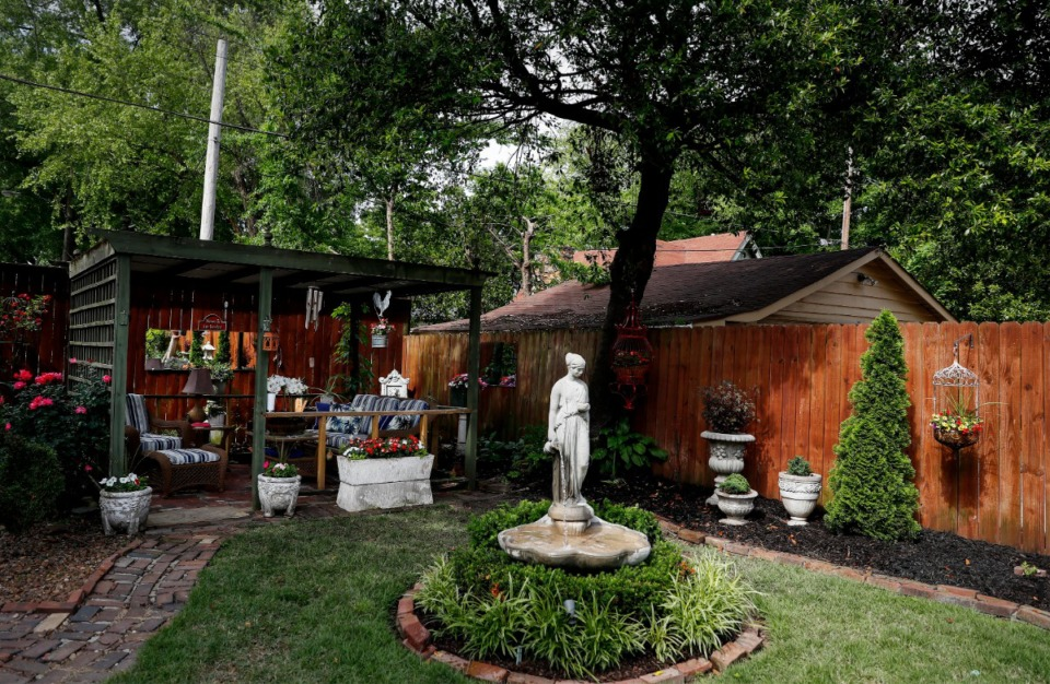 <strong>The backyard garden of Tommy Langston and Jimmy Thomason will be one of the 90 homes featured in the Cooper-Young Garden Walk on May 15-16.</strong> (Mark Weber/Daily Memphian)
